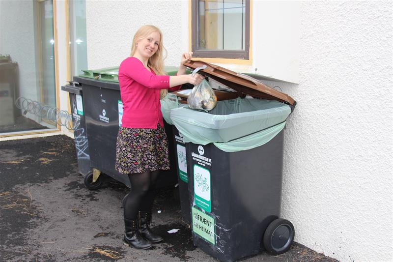 Staff member recycles organic waste