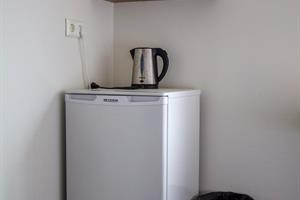 A fridge in the room