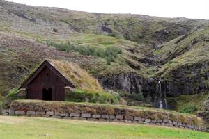 Sod church and waterfall at Þjóðveldisbær