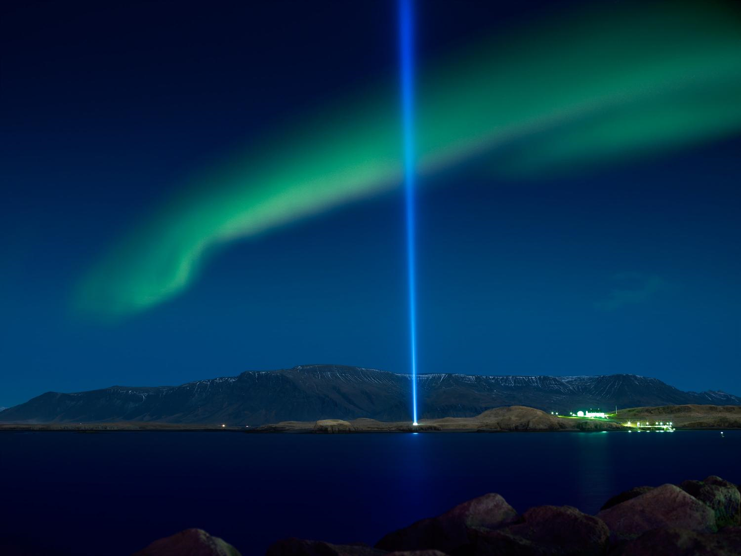 Northern lights over Reykjavík and Imagine Peace Tower