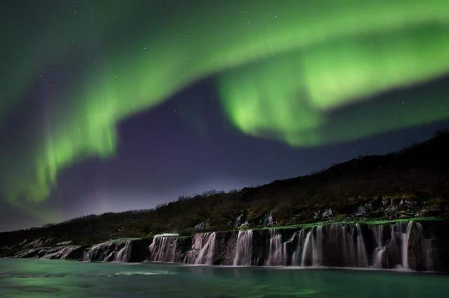 Aurora borealis over Hraunfossar waterfalls