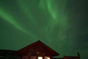 Cottage under northern lights