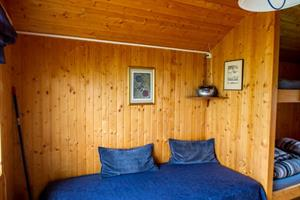 A single bed in one of the cottages