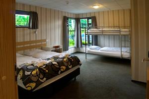 Double room with additional bunk beds. Private bathroom. Ideal for families.