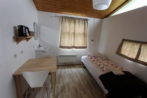 Room with shared bathroom