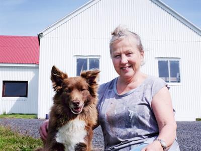 The host Bergþóra and her dog Bella