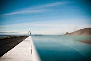Hofsós thermal pool by sea shore with spectacular view over Skagafjörður bay - North