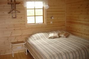 Bedroom with a double bed and a bunk bed