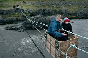 Those who dare can tow themselves across the Jökulsá River in a traditional cableway.