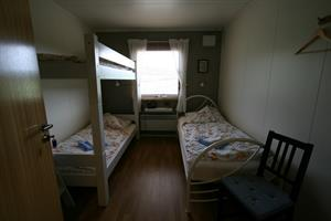 Twin room with shared bathroom and an extra upper bunk