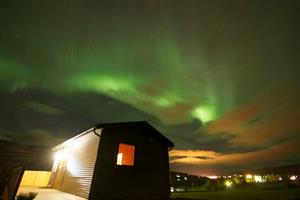 Northern lights dancing above Silva Holiday Homes