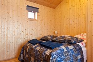 Bedroom with a double bed in the Sunset Cottage