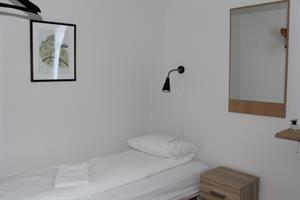 Room with shared bathroom in Langhús