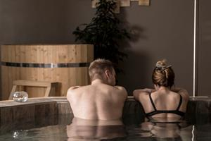 Soak in the warm waters of the hot tub at Baðhúsið Spa