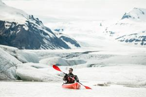 Paddle beneath the glaciated mountains and enjoy Icelandic nature