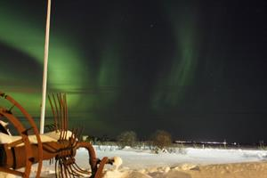 Northern lights dancing on the sky near Hotel Vos