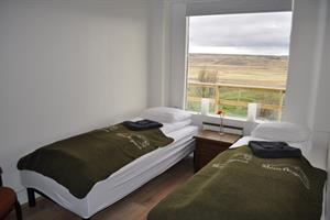 Accommodation in double, twin or family rooms with shared bathroom