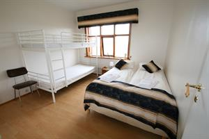Double room with shared bathroom and an additional bunk bed