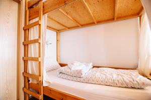 Economy family room with private bathroom. The room accommodates 6 persons in bunk beds.