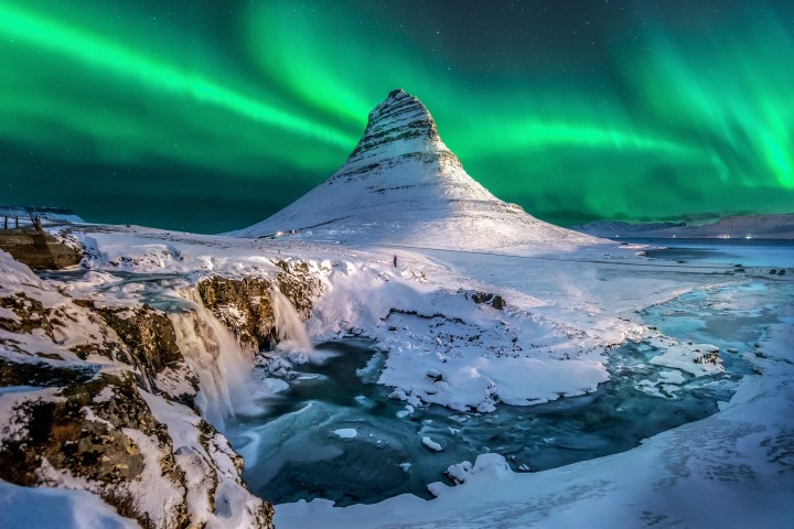 Kirkjufell Mountain under a display of Northern Lights