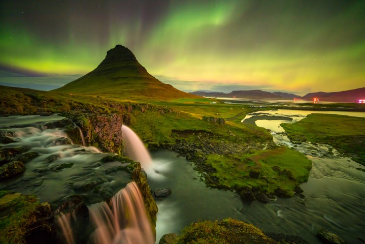 Northern Lights Dancing Around Kirkjufell Mountain In Iceland