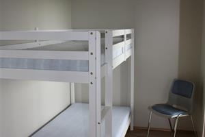 bunk bed in a separate room.