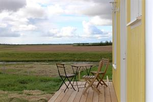 Each unit cottage has its own veranda where you can enjoy a beautiful view of the countryside