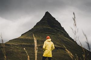 Man standing in front of Kirkjufell