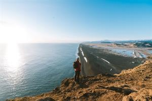 Hiking for stunning views over black sand beach in Iceland