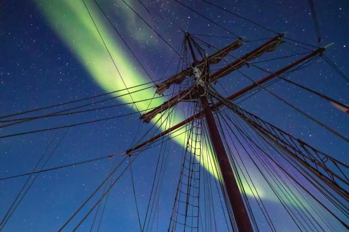 Northern Lights gazing on a sailboat