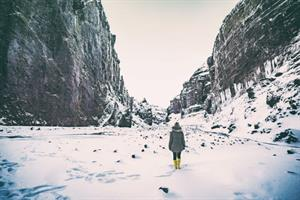 Walking into a snowy canyon