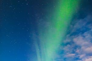 Man standing under Northern Lights