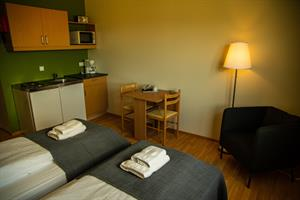 Double/ twin room with private bathroom and kitchenette.