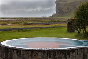 Hot tub with a view towards Reynisdrangar