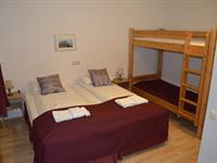 Double room with a bunk bed and shared bathroom