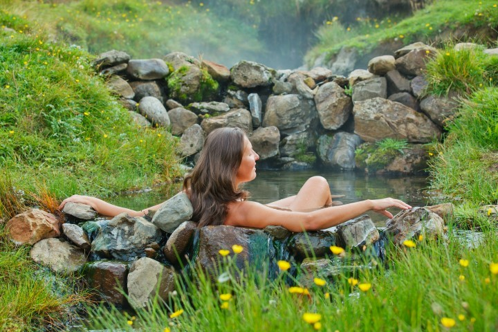 Bathing in a natural hot spring in Iceland