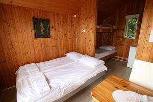 Double room with private bathroom and an additional bunk bed in a unit cottage