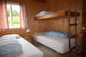 Two single beds and an upper bunk in each bedroom