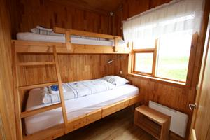A room with a bunk bed