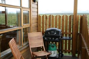 A BBQ and a part of the veranda