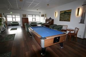 Living room with a pool table