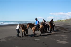 Riding on the black beach