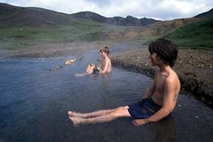 Relaxing in the hot river during the hot spring tour
