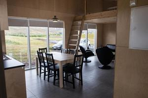 Dining area and sleeping loft of a larger sized cottage