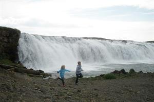 Running by Faxi Waterfall, South Iceland