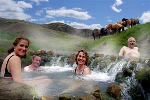 Relaxing in Reykjadalur Hot Springs