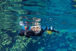 Snorkeling in the crystal clear water in Silfra
