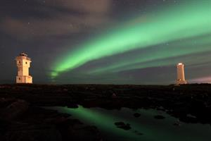 Northern lights dancing in the sky above the lighthouses at Akranes, West Iceland