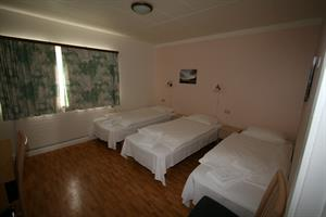 Triple room with shared bathroom