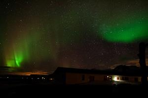 Northern lights over guesthouse Langaholt